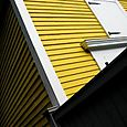 Yellow wooden house, angle