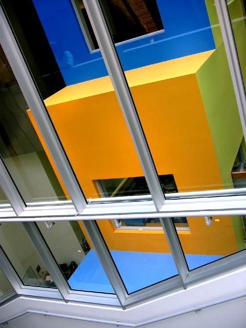 Stata, coloured walls through glass over atrium