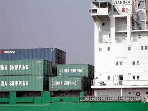 Containers on board, on the Huangpu River