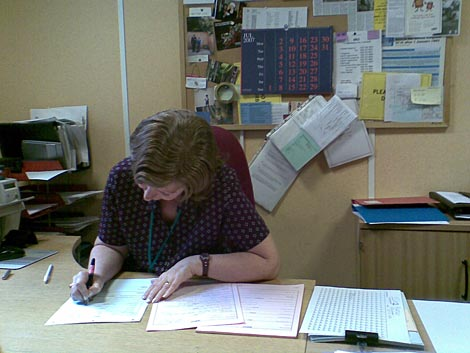 Registrar drawing up birth certificate