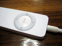 My iPod Shuffle seen in repose at Apostrophe cafe, wondering who or what it is
